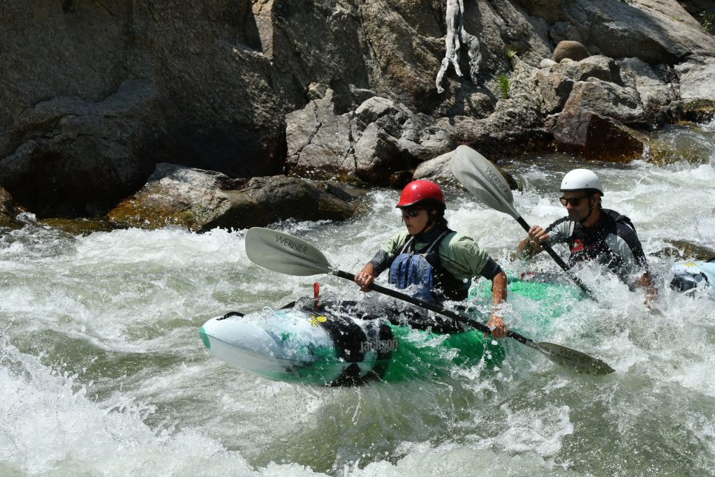Stacy Gold and husband paddling tandem whitewater kayak